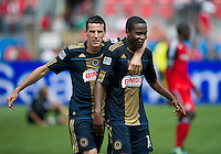 Philadelphia Union midfielder Sebastien Le Toux #9 and Philadelphia Union forward Danny Mwanga #10 embrace during an MLS game between the Philadelphia Union and the Toronto FC at BMO Field in Toronto on May 28, 2011..The Philadelphia Union won 6-2..