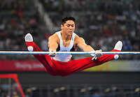Aug. 9, 2008; Beijing, CHINA; Kai Wen Tan (USA) performs on the horizontal bars during mens gymnastics qualification during the Olympics at the National Indoor Stadium. Mandatory Credit: Mark J. Rebilas-