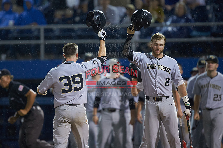 Ben Breazeale (39) of the Wake Forest Demon Deacons celebrates with teammate Johnny Aiello (2) after hitting a home run against the Florida Gators in Game One of the Gainesville Super Regional of the 2017 College World Series at Alfred McKethan Stadium at Perry Field on June 10, 2017 in Gainesville, Florida. The Gators defeated the Demon Deacons 2-1 in 11 innings. (Brian Westerholt/Four Seam Images)