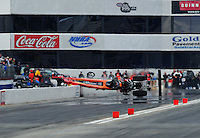 Feb. 11, 2012; Pomona, CA, USA; NHRA top alcohol dragster driver Mike Austin crashes and flies over the wall during the Winternationals at Auto Club Raceway at Pomona. Austin was unhurt in the incident. Mandatory Credit: Mark J. Rebilas-