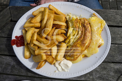 Cornwall, England. Cheese omlette and chips, mayonaise and ketchup.