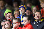 An expectant Sixmilebridge fan in the stand during their senior county final against Clooney-Quin at Cusack Park. Photograph by John Kelly.