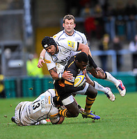High Wycombe, England. Christian Wade of London Wasps tackled during the Aviva Premiership match between London Wasps and Sale Sharks at Adams Park on December 23. 2012 in High Wycombe, England.