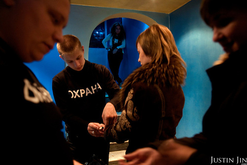 Security personnel search youngsters at the entrance to the Hollywood club in Tyumen. The Siberian city is enjoying a flush of cash from its oil and gas reserves.