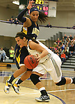 SIOUX FALLS, SD - JANUARY 2:  Taylor Varsho #3 from the University of Sioux Falls drives around a leaping Shaunteva Ashley #3 from Augustana in the second half of their game Friday night at the Stewart Center. (Photo by Dave Eggen/Inertia)