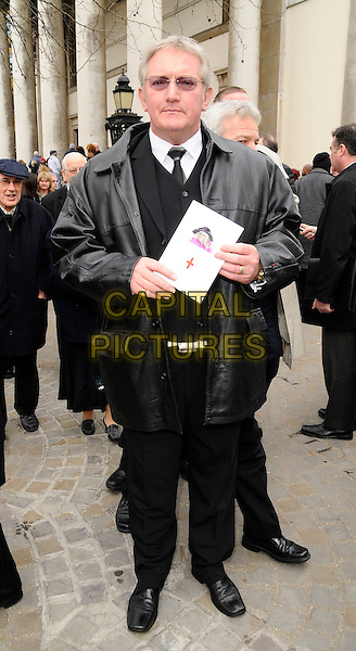 GRAHAM COLE.Wendy Richard's funeral service, St. Mary's Church, Marylebone High St., London, England..March 9th, 2009.burial mourning services death full length black leather jacket trousers .CAP/CAN.©Can Nguyen/Capital Pictures.
