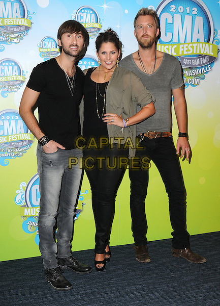 Lady Antebellum - Dave Haywood, Hillary Scott, Charles Kelley.2012 CMA Music Festival Nightly Press Conference held at LP Field, Nashville, Tennessee, USA..June 7th, 2012.full length black top jeans denim grey gray t-shirt.CAP/ADM/GS.©George Shepherd/AdMedia/Capital Pictures.