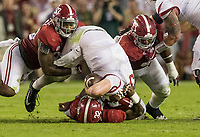 Hawgs Illustrated/BEN GOFF <br /> Cole Kelley, Arkansas quarterback, gets sacked by Alabama linebackers Anfernee Jennings (33) and Rashaan Evans (32) in the second quarter Saturday, Oct. 14, 2017, at Bryant-Denny Stadium in Tuscaloosa, Ala.