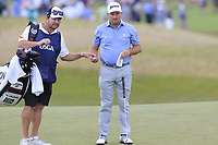 Graeme McDowell (NIR) and Ken Comboy on the 9th green during Thursday's Round 1 of the 118th U.S. Open Championship 2018, held at Shinnecock Hills Club, Southampton, New Jersey, USA. 14th June 2018.<br /> Picture: Eoin Clarke | Golffile<br /> <br /> <br /> All photos usage must carry mandatory copyright credit (&copy; Golffile | Eoin Clarke)