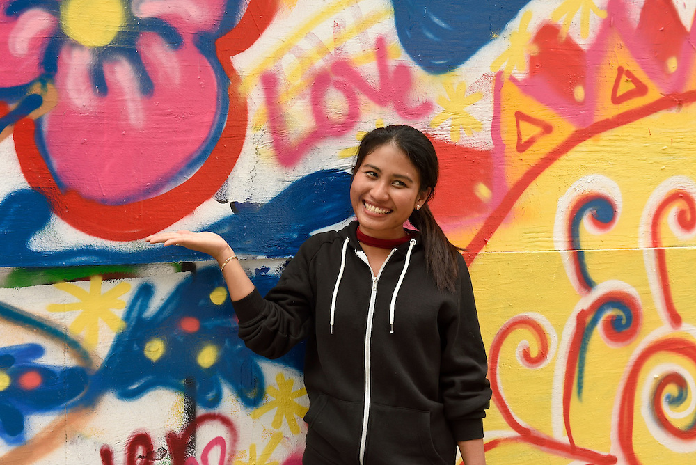 A participant proudly poses in front of the artwork.