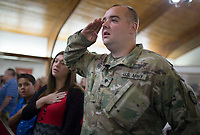 NWA Democrat-Gazette/CHARLIE KAIJO Army National Guard Specialist, Matthew Snider, of Bentonville recites the Pledge of Allegiance on Sunday, November 12, 2017 at Monte Ne Baptist Church in Rogers. The church held a special Veterans Day color guard ceremony with special guests from the American Legion Post 100