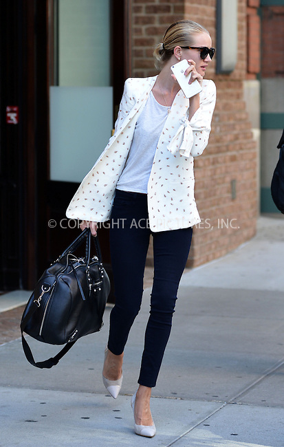 WWW.ACEPIXS.COM<br /> <br /> June 9 2015, New York City<br /> <br /> Model and actress Rosie Huntington-Whiteley leaves a downtown hotel on June 9 2015 in New York City<br /> <br /> By Line: Curtis Means/ACE Pictures<br /> <br /> <br /> ACE Pictures, Inc.<br /> tel: 646 769 0430<br /> Email: info@acepixs.com<br /> www.acepixs.com