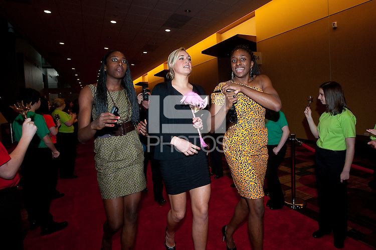 INDIANAPOLIS, IN - APRIL 1, 2011: Chiney Ogwumike, Joslyn Tinkle and Nnemkadi Ogwumike walk the red carpet at the Indianapolis Convention Center at Tourney Town during the NCAA Final Four in Indianapolis, IN on April 1, 2011.