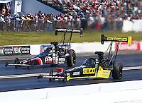 Jun. 1, 2014; Englishtown, NJ, USA; NHRA top fuel driver Richie Crampton (near) races alongside Dom Lagana during the Summernationals at Raceway Park. Mandatory Credit: Mark J. Rebilas-