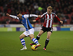 Kieron Morris of Walsall tussles with Mark Duffy of Sheffield United during the English Football League One match at Bramall Lane, Sheffield. Picture date: November 29th, 2016. Pic Jamie Tyerman/Sportimage