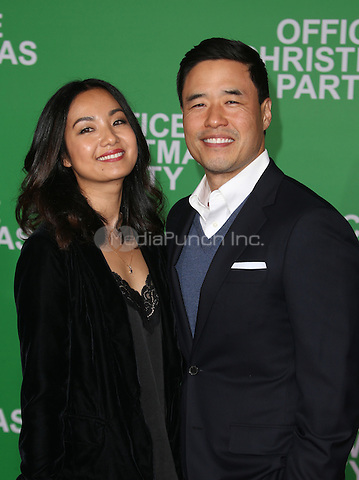 """Westwood, CA - DECEMBER 07: Randall Park, Jae Suh Park, At Premiere Of Paramount Pictures' """"Office Christmas Party"""" At Regency Village Theatre, California on December 07, 2016. Credit: Faye Sadou/MediaPunch"""