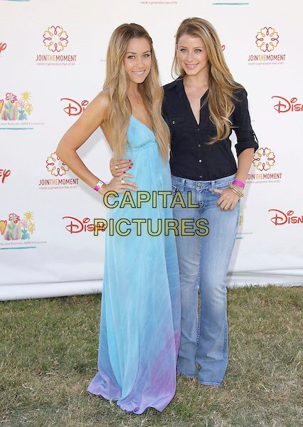 "LAUREN CONRAD & LAUREN ""LO"" BOSWORTH.The 20th annual ""A Time for Heroes"" Celebrity Carnival benefiting Elizabeth Glaser Pediatric AIDS Foundation held at Wadsworth Theater on the Veteran Administration Lawn in West Los Angeles, California, USA. .June 7th, 2009.full length blue purple long maxi dress hand on hip jeans denim black top .CAP/DVS                                                  .©Debbie VanStory/Capital Pictures."