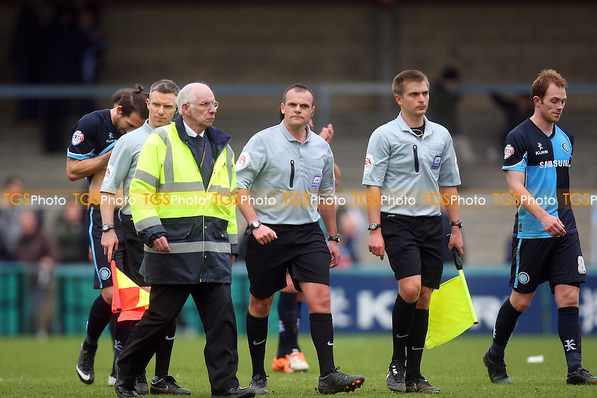 Referee Mr G Eltringham is escorted from the pitch at the end of the game - Wycombe Wanderers vs Dagenham and Redbridge, Sky Bet League Two Football at the Adams Park Stadium - 05/04/14 - MANDATORY CREDIT: Dave Simpson/TGSPHOTO - Self billing applies where appropriate - 0845 094 6026 - contact@tgsphoto.co.uk - NO UNPAID USE