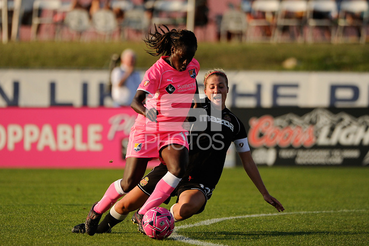 Eniola Aluko (18) of Sky Blue FC is defended by Becky Edwards (14) of the Western New York Flash. The Western New York Flash defeated Sky Blue FC 2-0 during a Women's Professional Soccer (WPS) match at Yurcak Field in Piscataway, NJ, on July 17, 2011.