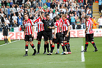 Npower Championship, Swansea City FC (white) V Sheffield United. Sat 7th May 2011 (12.45pm KO)<br /> Pictured: Match referee E L Ilderton (C) shows a red card to Shane Lowry of Sheffield United (L) for saving the ball with his hand which resulted in a succesful Scott Sinclar penalty kick which put swansea two nil up<br /> Picture by: Ben Wyeth / Athena Picture Agency<br /> info@athena-pictures.com<br /> 07815 441513
