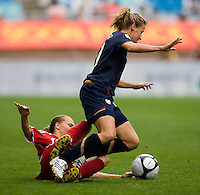 USWNT midfielder (10) Aly Wagner is fouled by Canada's (17) Brittany Timko during the finals of the Peace Queen Cup.  The USWNT defeated Canada, 1-0, at Suwon World Cup Stadium in Suwon, South Korea.