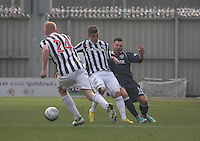 Graham Carey (centre) tackles Ivan Sproule in the St Mirren v Ross County Clydesdale Bank Scottish Premier League match played at St Mirren Park, Paisley on 19.1.13.