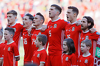 (L-R)  David Brooks, Harry Wilson, Connor Roberts, Joe Allen (R) sing the national anthem during the UEFA EURO 2020 Qualifier match between Wales and Slovakia at the Cardiff City Stadium, Cardiff, Wales, UK. Sunday 24 March 2019