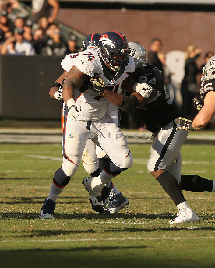 Denver Broncos Orlando Franklin (74) during a game against the Oakland Raiders on November 9, 2014 at O.co Coliseum in Oakland, CA. Denver beat Oakland 41-17.