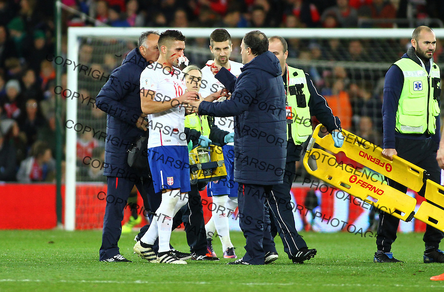 (copyright &amp; photo: STARSPORT)<br /> 12.11.16 World Cup Qualifier -  European Group D - Wales v Serbia -<br /> Dusan Tadic of Serbia leaves the field for treatment