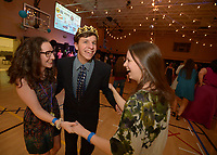 NWA Democrat-Gazette/ANDY SHUPE<br /> Brenden Groves (center) of Rogers laughs Friday, Feb. 9, 2018, as he dances with Macy Valentine (left) and Hailey MacFarlane during the Night to Shine, a prom night for people with special needs ages 14 and older, at Cross Church in Springdale. The event, which is sponsored by the Tim Tebow Foundation, features hair and makeup assistance, limousine rides, a dinner and dancing.