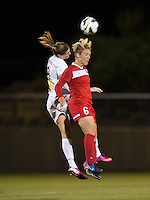 Adriana Martin (8) of the Western NY Flash goes up for a header with Lori Lindsey (6) of the Washington Spirit during the game at the Maryland SoccerPlex in Boyds, MD.  Washington tied Western NY, 1-1.