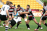 Kristian Ormsby tries to break out of Tom Symes tackle during the Air New Zealand Cup rugby game between Counties Manukau & Hawkes Bay played at Mt Smart Stadium, 30th of September 2006. Hawkes Bay won 30 - 29.