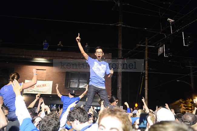 UK fan Jon Tsang celebrates at the intersection of Woodland Ave. and Euclid Ave. in Lexington, Ky., after their victory over Kansas in the NCAA Basketball Championship game on 4/3/12. Photo by Mike Weaver | Staff
