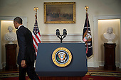 United States President Barack Obama departs after making a live statement to the nation concerning historic changes in U.S. relations with Cuba in the Cabinet Room of the White House in Washington, D.C. on Wednesday, December 17, 2014.  In his remarks the President announced he planned to start talks with Cuba to normalize ties and open an embassy as a result of the release of Alan Gross. <br /> Credit: Doug Mills / Pool via CNP