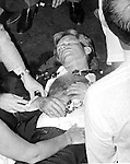 Robert F. Kennedy assassination Ambassador Hotel Los Angeles CA Ron Bennett Photo's, Bobby Kennedy after being shot by Sirhan Sirhan, Sirhan Sirhan held by RFK staff and Rosey Grier, Robert F. Kennedy, RFK, Bobby, Bobby Kennedy, assassination of RFK, assassination, assassination of Robert F. Kennedy, Ethel Kennedy, June 5 1968, Sirhan Sirhan,  Ambassador Hotel Los Angeles California, Rosey Grier, George Plimpton, Rafer Johnson, Photojournalism, Photojournalist, collecting editing, presenting news photographs, Photojournalism provides visual support for stories, mainly in the print media,  Commercial photography's main focus is to sell a product or service. Fine Art photography are photographs that are created to fulfill the creative vision of the photographer, Photojournalism provides visual support for stories, mainly in the print media,  RFK Photo's by Ron Bennett, Robert F. Kennedy photographs by Ron Bennett, Robert F.  Bobby Kennedy assassination photographs by Ron Bennett, Sirhan Sirhan photographs by Ron Bennett, RFK Photographs by Ronald T. Bennett, Fine Art Photography by Ron Bennett, Fine Art, Fine Art photography, Art Photography, Copyright RonBennettPhotography.com ©