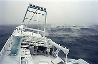 "Ice fog accompanies the fishing vessel ""Kiska Sea"" as it fishes for opilio crab in the Bering Sea in January and February of 1995.  The Bering Sea is known for having the worst storms in the world. Ice fog is formed when the air is colder than the water. The boat is covered in ice from sea spray coming over the sides.  Crab fishing in the Bering Sea is considered to be one of the most dangerous jobs in the world.  This fishery is managed by the Alaska Department of Fish and Game and is a sustainable fishery.  The Discovery Channel produced a TV series called ""The Deadliest Catch"" which popularized this fishery."