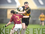 St Josephs Milltown's Shane Curtin  and Currow's Dan O'Shea in action during the St Josephs Milltown V Currow Munster Intermediate Club football semi final at Milltown Malbay on Sunday. Photograph by Eamon Ward