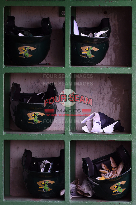 Beloit Snapper helmets and batting gloves in the dugout helmet rack during a game against the Clinton LumberKings on August 17, 2014 at Ashford University Field in Clinton, Iowa.  Clinton defeated Beloit 4-3.  (Mike Janes/Four Seam Images)