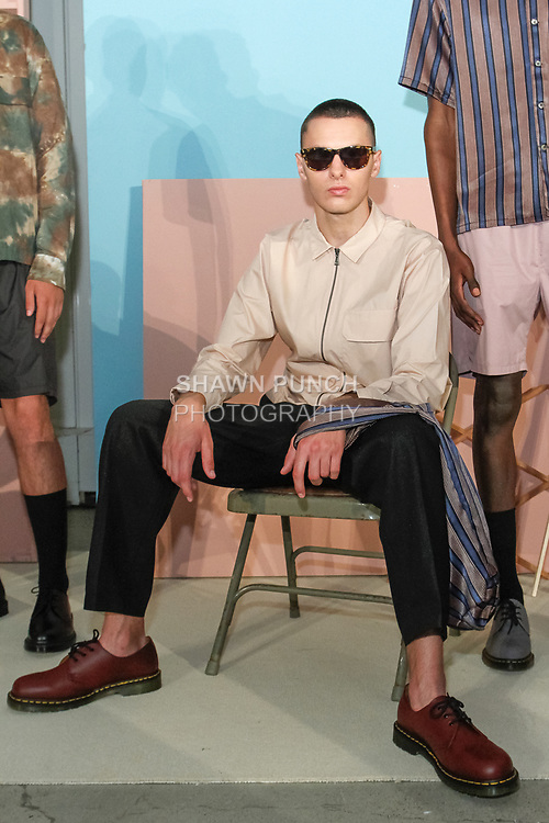 "Model poses in an outfit from the Maiden Noir Spring Summer 2018 ""Return To Stone Garden"" collection by Nin Truong, for New York Mens Day at Dune Studios on July 10, 2017; duing New York Fashion Week: Mens Spring Summer 2018."