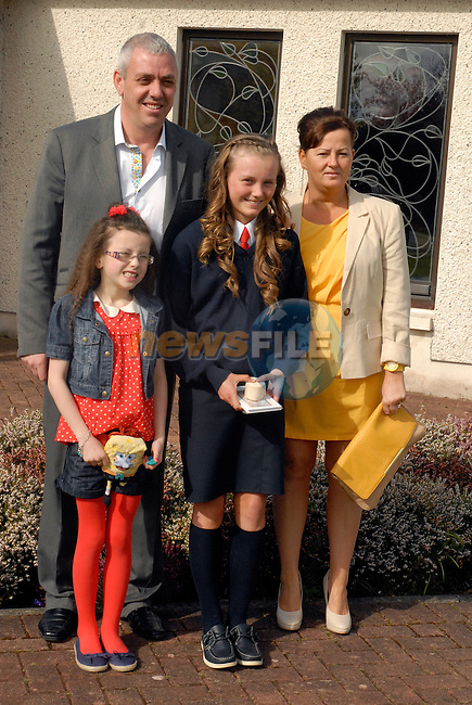 Robyn McEvoy with her parents Anna and Lee and little sister Ali (8) at her confirmation in the Star of the Sea Church, Mornington. Photo: www.newsfile.ie