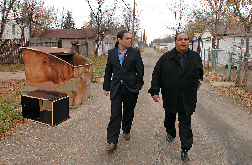 "Congress of Aboriginal Peoples (CAP) president Patrick Brazeau, left, takes a stroll down a North Central alley with anti-gang advocate Kevin ""Kubby"" Daniels. ""You wouldn't want to walk down this alley at night,"" Daniels told Brazeau. Brazeau went on to become the youngest member of the Canadian Senate, was suspended for expense fraud, plead guilty to assault and cocaine possession charges, and then recently returned to the Senate. MARK TAYLOR GALLERY"