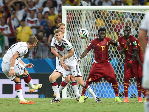 21.06.2014. Fortaleza, Brazil. Germany's Bastian Schweinsteiger (L) shoots a free kick during the FIFA World Cup 2014 group G preliminary round match between Germany and Ghana at the Estadio Castelao Stadium in Fortaleza, Brazil, 21 June 2014.