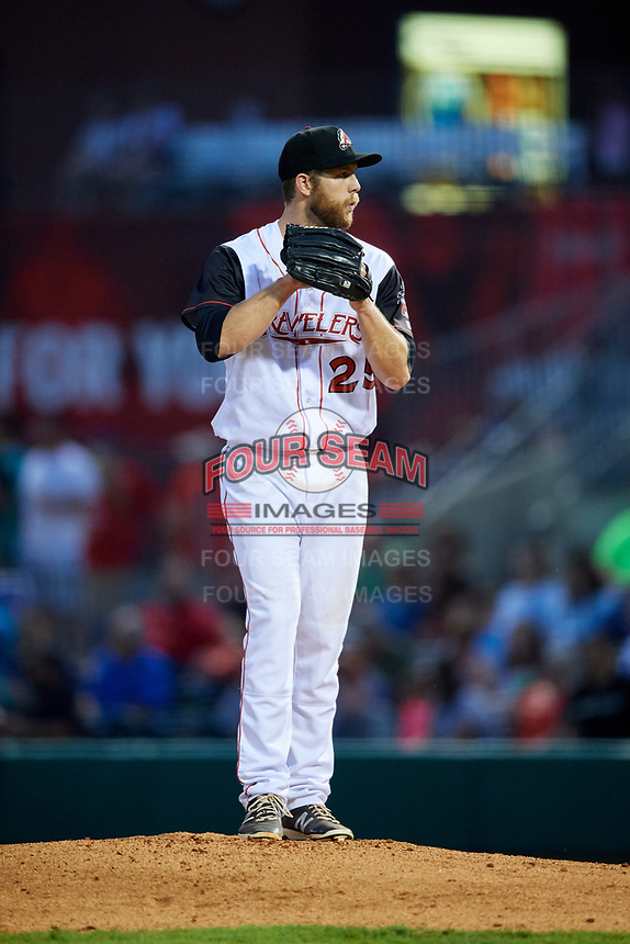 Arkansas Travelers relief pitcher Lindsey Caughel (25) gets ready to deliver a pitch during a game against the Frisco RoughRiders on May 26, 2017 at Dickey-Stephens Park in Little Rock, Arkansas.  Arkansas defeated Frisco 4-2.  (Mike Janes/Four Seam Images)