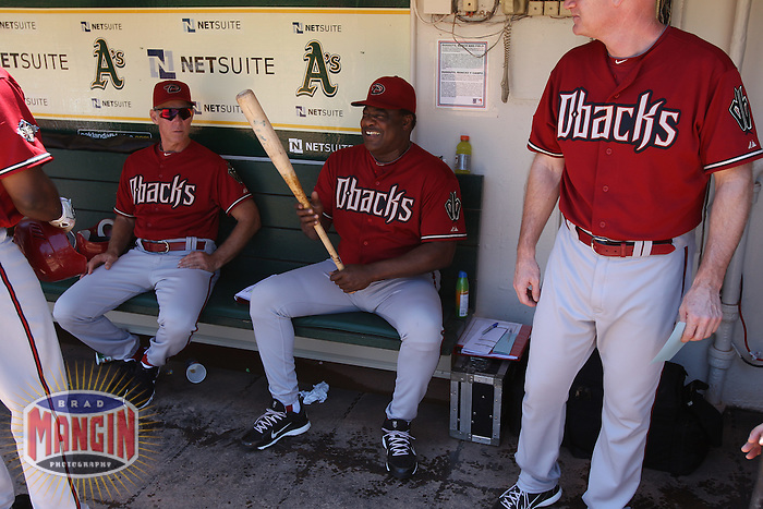 OAKLAND, CA - JULY 3:  Justin Upton #10, coach Alan Trammell #3, coach Don Baylor #25 and coach Matt Williams #9 of the Arizona Diamondbacks get ready in the dugout before the game against the Oakland Athletics at the Oakland-Alameda County Coliseum on July 3, 2011 in Oakland, California. Photo by Brad Mangin