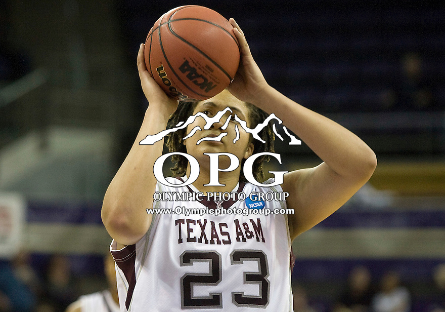 20 March 2010:  Texas A&M center #23 Danielle Adams attempts a free throw against Portland State. Texas A&M won 84-53 over Portland State in the first round of the NCAA Women's Basketball Tournament held at the Bank of America Arena in Seattle, WA.