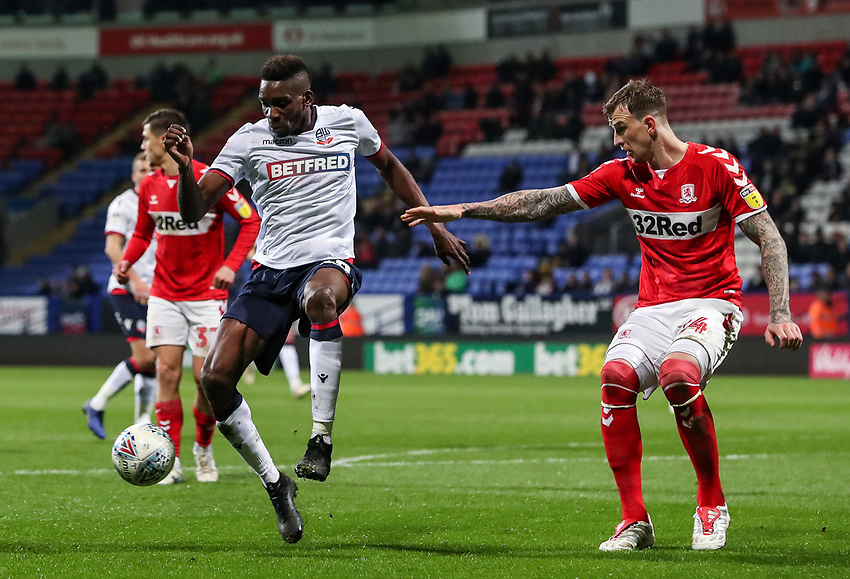 Bolton Wanderers' Sammy Ameobi competing with Middlesbrough's Aden Flint <br /> <br /> Photographer Andrew Kearns/CameraSport<br /> <br /> The EFL Sky Bet Championship - Bolton Wanderers v Middlesbrough -Tuesday 9th April 2019 - University of Bolton Stadium - Bolton<br /> <br /> World Copyright © 2019 CameraSport. All rights reserved. 43 Linden Ave. Countesthorpe. Leicester. England. LE8 5PG - Tel: +44 (0) 116 277 4147 - admin@camerasport.com - www.camerasport.com