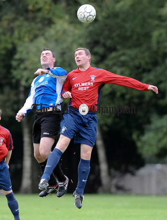 Patrick Mannion of Hermitage in action against Francis Daniels of Rock Rovers during their Premier League game at The Fair Green, Ennis. Photograph by John Kelly.