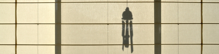 Shadow of a wind chime on the blinds of a house at Newport, a suburb on the northern beaches of Sydney.