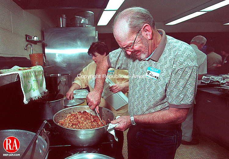 WATERBURY, CT 11/26/98 --1126JH04.tif--Richard Szekeres of Naugatuck stirs the pot of stuffing  while working in the kitchen at the United Methodist Church in Waterbury Thursday during its annual Thanksgiving dinner. About 100 people were served, either at the church, or had dinners delivered to them. JOHN HARVEY staff photo for Sean story.