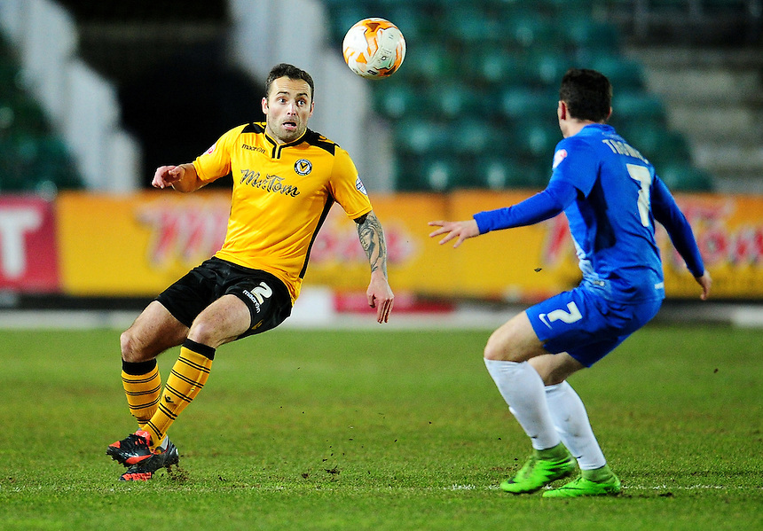 Newport County's Danny Holmes under pressure from Hartlepool United's Nathan Thomas<br /> <br /> Photographer Kevin Barnes/CameraSport<br /> <br /> Football - The Football League Sky Bet League Two - Newport County v Hartlepool United - Tuesday 15th March 2016 - Rodney Parade - Newport<br /> <br /> &copy; CameraSport - 43 Linden Ave. Countesthorpe. Leicester. England. LE8 5PG - Tel: +44 (0) 116 277 4147 - admin@camerasport.com - www.camerasport.com